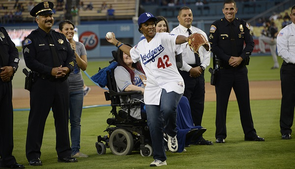 Photo of District Attorney Lacey throwing pitch at Dodger Stadiu